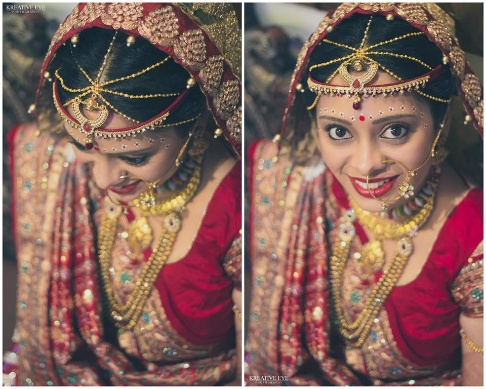 bride looking amazingly stunning in the traditional RED lehenga !!