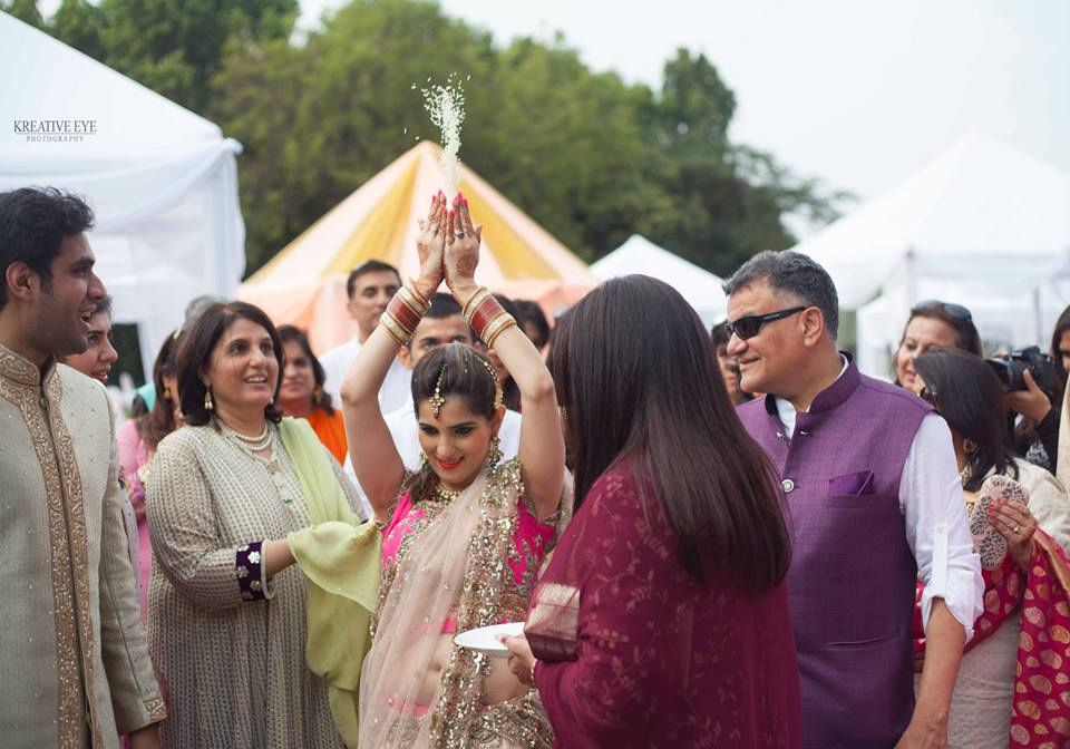 the bride wishing her parent's house remain prosperous for the love they have bestowed on her